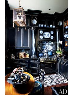 Decorating Your Kitchen with Black | Architectural Digest - painted cabinets: rubbed black over Chinese blue, limned in gold.