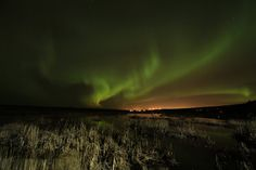 Northern Lights illuminate the sky over Anchorage, Alaska, on Oct. 13, 2012.