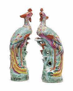 A PAIR OF CHINESE EXPORT PORCELAIN FAMILLE ROSE PHOENIXES -  LATE 19TH/20TH CENTURY -  Each brightly enameled, modeled standing on pierced rockwork, one claw clenching a sacred fungus  15 ¾ in. (40 cm.) high