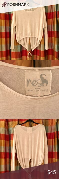 "Nesh NYC Tunic NWOT Gorgeous ""Nesh - Made in NYC"" Tunic. Soft, flowy cream colored long sleeve tunic.  Corded along the hem to cinch in or leave loose.  Unique yoga-inspired clothing made in NYC. Great layering piece.  In new condition. Nesh Tops Tunics"