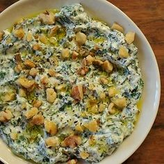 Yoghurt & Spinach Dip, or 'Borani Esfanaaj', in Persian - Blend up spinach and yogurt with olive oil and garlic then top with walnuts and get ready to dip! Found at www.edamam.com.