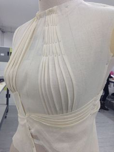 Draping on the stand - bodice design with pleated structure to accentuate the bust & waist - fabric manipulation; fashion design; couture techniques: