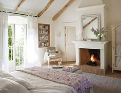 Love the doors, the fireplace, and the use of white.  The fact that it's in Spain is also nice. ♡