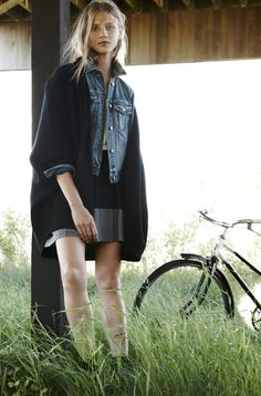 Madewell sculptor cardigan worn with premiere skirt.