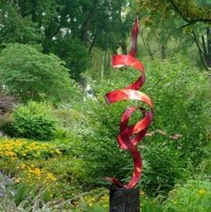 Modern Garden Art..this would look great in my garden next to the shed