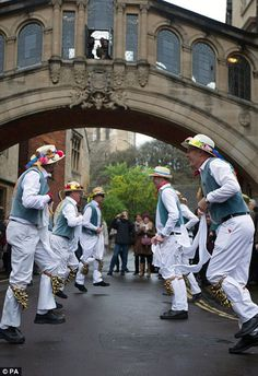 Morris dancers entertain the crowd on Mayday morning near the Bodleian Library in Oxford...