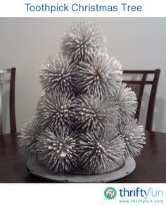 Toothpicks and Styrofoam balls come together to make an amazingly elegant table top Christmas tree.