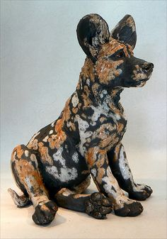 african wild dog pup - raku sculpture
