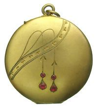 Art nouveau locket with suspended ruby detail
