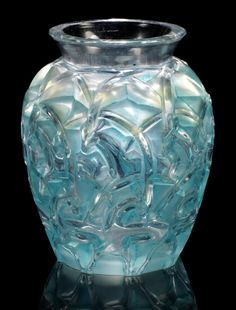 René Lalique  'Chamois' a Vase, design 1931  polished and frosted glass, heightened with blue staining  12.2cm high, etched 'R. Lalique France'