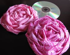 Easy roses by using torn fabric on a CD for a base!