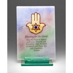 This free standing plaque combines a rainbow background with a gold Hamsa and the words to the Home Blessing. Comes with glass stand
