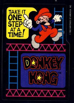 """Topps Donkey Kong Trading Cards - Card 05 :-: Sticker number five in the series...with great similar colors to all the other sticker...this is one big sticker featuring Mario about to climb a ladder and the caption...""""Take it one step at a time!"""". Great advice for life...and for completing Donkey Kong."""