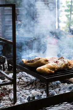 The chicken is then browned on a grate over a low bed of embers that radiate a consistent and intense heat. (Photo: Evan Sung for The New York Times)