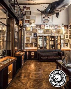 i really like the stacked artwork Tattoo Shop Decor, Tattoo Studio Interior, Tattoo Convention, Best Tattoo Shops, Graffiti Wall Art, Traditional Artwork, Shop Interiors, Shop Interior Design, Tattoos