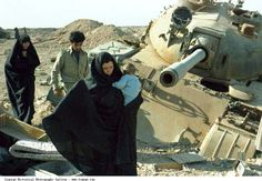 1980s iranian women | Iran Iraq War (1980-1988) A Woman in chador is holding her Child while ...