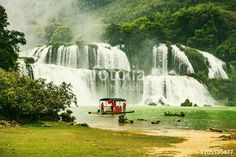 Tourists on the boat are going to enjoy and explore Ban Gioc waterfall. Stunning scenery of Ban Gioc waterfall in Cao Bang Province, Vietnam