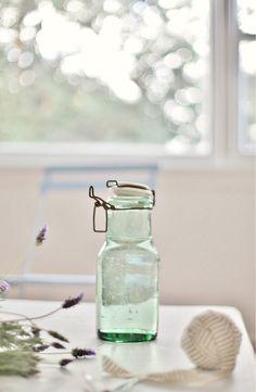 vintage French bottle for coastal beach decor  via A Beach Cottage