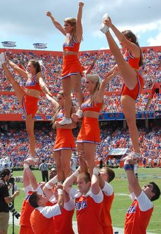 This is a pyramid stunt, we learned how to do these in class and tried a couple