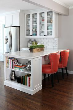 Kitchen peninsula - Kitchen / House on the Left- book shelf at the end of peninsula. Greige paint on walls and beam with white moulding, cabinets, subway tile & dark hardwood floors. Kitchen Redo, New Kitchen, Kitchen Ideas, Kitchen Nook, Kitchen Cupboards, Kitchen Bar Counter, 1970s Kitchen, Breakfast Bar Kitchen, Breakfast Nooks