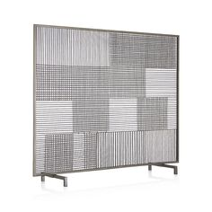 """A clean and simple, graphic grid of """"crosshatching"""" plaid is handcrafted of iron wire with a beautiful antiqued zinc finish. Mid-century modern design coordinates with a wide variety of decorative styles."""