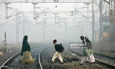 Indian school children cross mist enveloped railway lines on their way to school in New Delhi, early 03 January 2008. At least 47 people have died because of a biting cold wave sweeping northern India over the last two weeks, media reports said.The northern Uttar Pradesh state was worst hit, with 38 people freezing to death since the start of the chill in the last week of December, the Press Trust of India reported. New Delhi recorded the season's lowest temperature of 1.9 degrees Celsius…