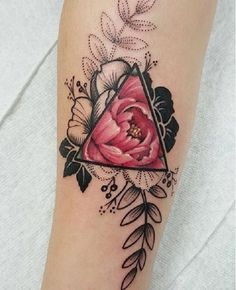 A very well detailed Triangle Glyph Tattoo. You can see that the pink flower is fully colored within the glyph triangle symbol as it slowly branches out into the less colored parts of the flower as the colors are only concentrated in the center.