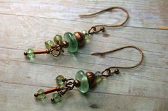 I am in love with these recycled African Glass disk beads. They are frosty green like a coke bottle and pair nicely with the AB green Czech