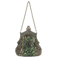 "Love things Victorian? This decorated purse of deep, Midori-green satin captures the era, encrusted with hundreds of green stones, sequins, crystals, and beads. Snap-top closure; interior coin pocket. Includes detachable 15"" and 48"" brass chains. 6""L x 7 1/2""H x 3""W."