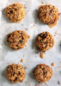 Healthy Carrot Cake Oatmeal Cookies - made with coconut oil and topped with a cinnamon glaze! These are perfect.