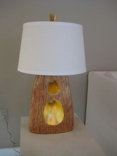 """C-Through 2 Table Lamp  Cast base with gilded finish, linen shade with banded edge.  10.5"""" x 5.5"""" (base) x 26""""H"""