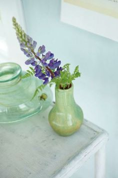 Benjamin Moore's Breath of Fresh Air sets a peaceful tone alongside cottage accents and a sprig of lavender on a side table. | Photo: Courtesy of Benjamin Moore | thisoldhouse.com