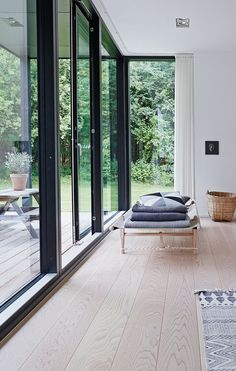 Daybed in light wood in front of the big windows, is a perfect spot for a small break. Its classical design gives a calm Huge Windows, Black Windows, Floor To Ceiling Windows, Interior Windows, Interior Exterior, Big Window Curtains, Fire Doors, Living Room Windows, Window Design