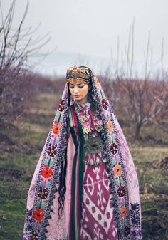 Tajik girl in traditional clothes. Photo by Nani