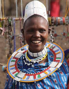 Beauty in Blue. Maasai village. The women display their beadwork. Tanzania, Arusha