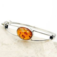 Elegant Sterling Silver Natural Baltic Amber Cuff Bracelet  Price : $145.95 http://www.silverplazajewelry.com/Elegant-Sterling-Silver-Natural-Bracelet/dp/B00H1ZC24Y