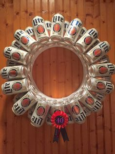 I made this Beer Can Wreath for Kathy's 40th Birthday party. It's made out of 32 cans of her favorite beer, styrofoam wreath from a craft store, lots of hot glue, and a 40th ribbon from Party City. I got the idea from a Google images search, and it was super easy to make.