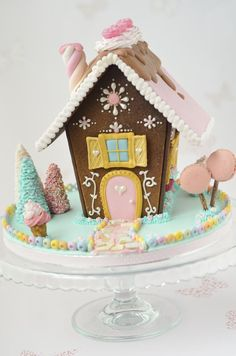 Love the macaroon trees and the marshmallow twist chimney on this gingerbread house!!