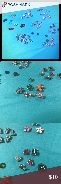 Origami Owl charms Choose any 8 charms (include in comments section)-Pic 2 snowflake, candy cane, peppermint Pic 3 red heart lock, love, crystal heart, red heart, rose, Pic 4 cardinal, dolphin, rainbow, kite, white flower, Pic 5 anchor, starfish, sunglasses, sand dollar, flip flops, airplane, palm tree Pic 6 W V L A P, megaphone, ballet, cake, baseball, helmet, best friend, crystal horseshoe Pic 7 green, gold, turquoise, red, clear, black, blue, brown & crystal. Please see pic 8 charms that…