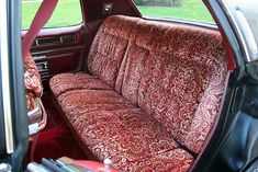 1975 Cadillac Fleetwood Brougham factory original Monticello Velour interior. This interior was a one year only option and is shown here in the dark red and gold pattern.