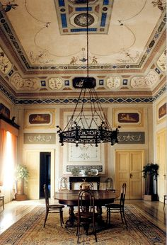Villa Spedalotta in Sicily. Dining perfection under that exquisite chandelier and neo-classical ceiling!