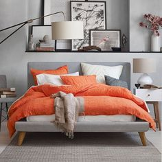 Autumn-Inspired Bedrooms Worth Falling For | Canvas: a blog by Saatchi Art. Try combining gray walls with shades of orange and hints of black to create a restful retreat with bursts of energizing color.