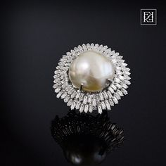 South sea pearl diamond baguette ring in 18kt white gold.