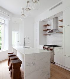 bright white kitchen with subway tile backsplash marble waterfall countertop and raw wood accents Kitchen Tiles, Kitchen Flooring, Kitchen Countertops, New Kitchen, Kitchen Dining, Kitchen Decor, Marble Counters, Kitchen Nook, Kitchen Modern