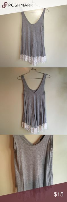 Staccato High Lo Lace Bottom Tank Staccato tank. Heather gray with white lace trim at bottom. Longer length and high low style-longer in the back. Scoop neck style with V cut in the back. Never worn but tried on in the boutique and its soooo cute! Perfect top for summer and fall. Smoke free home and ships same or next day! Tops Tank Tops