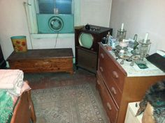 Another maple bedroom set, old television, beautiful cedar chest, first, 18 crystal dresser candlesticks, vanity sets, rugs