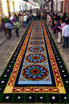 "Alfombras: Semana Santa in Antigua, Guatemala. Throughout Lent, and throughout Semana Santa (Holy Week) in Antigua, the streets would be covered in elaborate ""alfombras"" or carpets, made out of colored sawdust, fruits, vegetables, and a wide range of other materials."