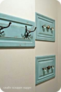 Cabinet doors repurposed with unique hardware as coat, hat or scarf racks.