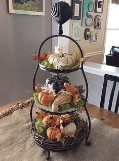 tiered centerpiece tray – 3 ways - - I found a beautiful tiered tray at HomeGoods a few weeks ago and I'm in love. It has a pretty but rustic look to it, taupe colored glass plates and a scallop decoration on top. Fall Home Decor, Autumn Home, Thanksgiving Decorations, Seasonal Decor, Fall Decorations, Fall Table Centerpieces, Thanksgiving Table, Table Halloween, Tiered Stand