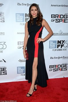 Strike a pose: Dobrev wore black and silver heels, and added a red floral clutch